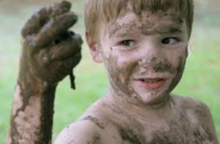 kid in mud