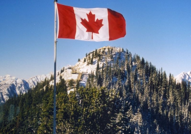 canadian flag and mountains