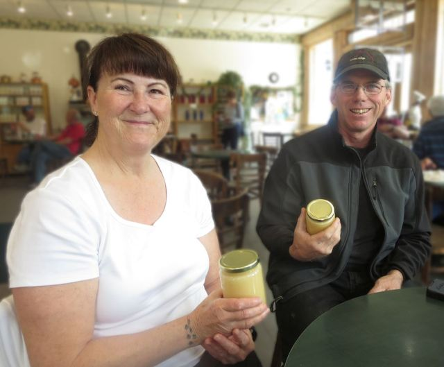 Brenda and Mike with some of their creamed honey.